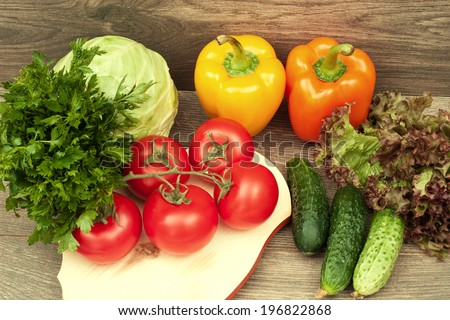 vegetables on a wooden background, top view