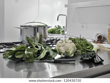 vegetables on the steel worktop in a modern kitchen - stock photo