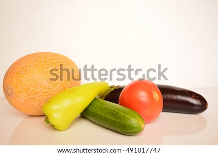 Vegetables on white background, cucumber, pepper, tomato