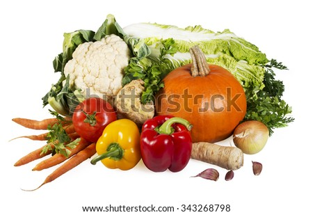 Vegetables on white- tomato, carrot, paprika, cauliflower, cabbage, onion, celery and parsley - stock photo