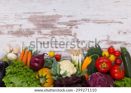 Vegetables on wood background with space for text - stock photo