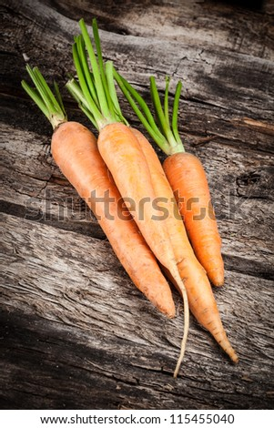 Vegetables on wood. Top view carrots background. Carrot on wood. Top view. Organic vegetables