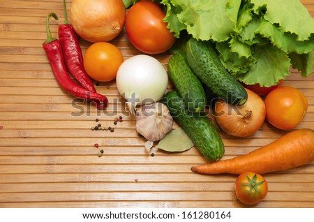 vegetables on wooden background - stock photo