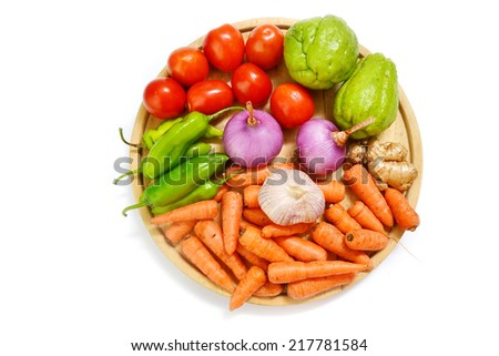 vegetables on wooden plate - stock photo