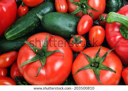 Vegetables. Organic vegetable healthy food tomato and cucumber close-up - stock photo