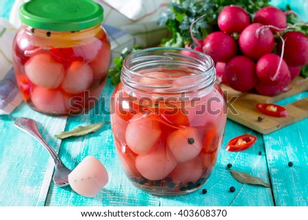 Vegetables, pickled radish and chili peppers on a wooden table. - stock photo