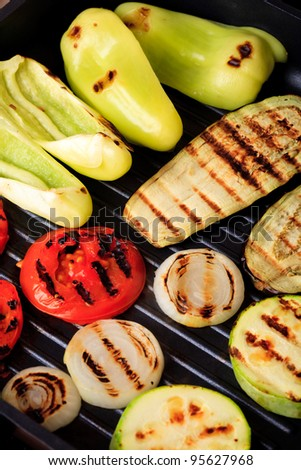 Vegetables prepared to cook on grill pan - stock photo