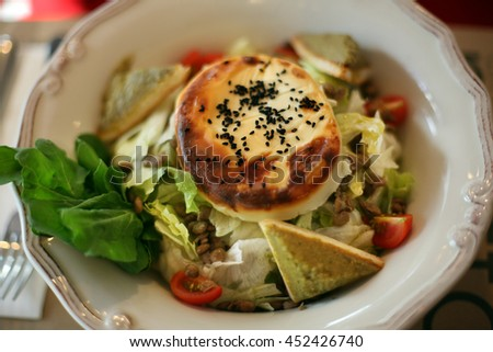 Vegetables salad with pastry on salad plate. - stock photo