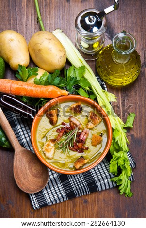 Vegetables soup with fresh vegetables all around the bowl - stock photo