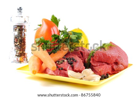 Vegetables spices and meat , on a white background