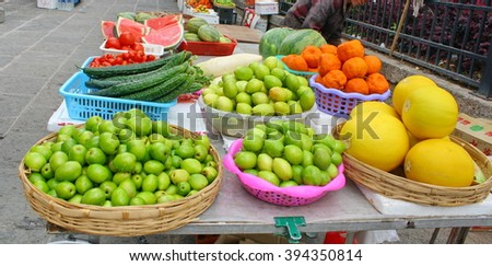 Vegetables stand at traditional market in China. - stock photo