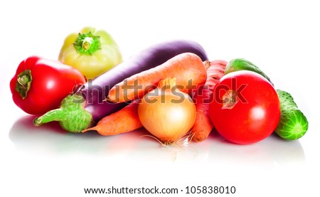 Vegetables: tomatoes, carrots, cucumbers, an eggplant, onion on a white background