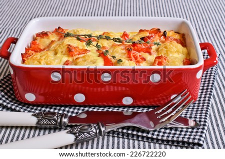 Vegetables with cheese crust in a ceramic baking dish - stock photo