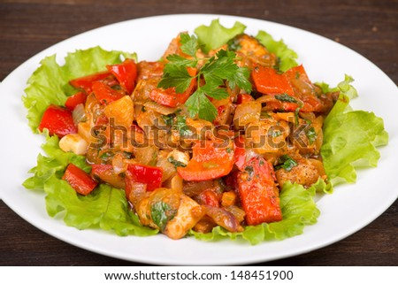 Vegetables with chicken in a curry sauce in white plate - stock photo