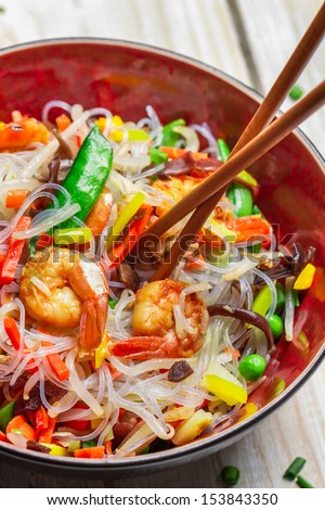 Vegetables with noodles and shrimp - stock photo