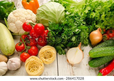 Vegetables with pasta on the table