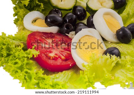 vegetale salad with olives - stock photo