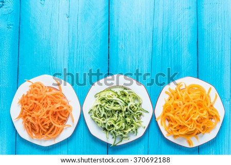 Vegetarian and healthy spaghetti, lay flat on table from above - stock photo