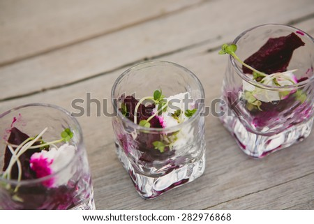 Vegetarian aperitif with beet, goat cheese and soy sprouts - stock photo