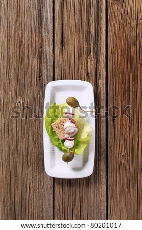 Vegetarian appetizer -  Mozzarella cheese, capers and onion on a wooden skewer - stock photo