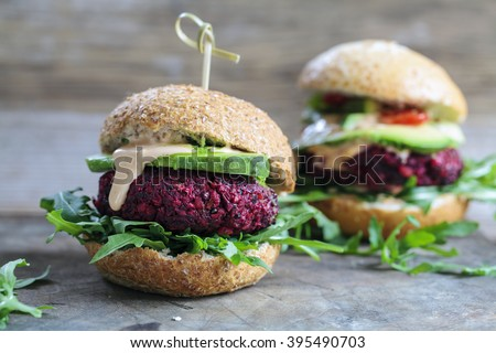 Vegetarian beetroot burgers with arugula and avocado