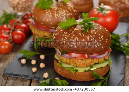 Vegetarian burger on a wooden background