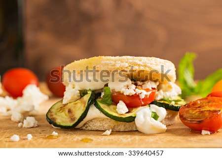 Vegetarian Burger with fried tomato and feta cheese