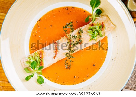 Vegetarian delicious vegetable soup with vegetable puree peppers, pumpkin and carrot  soup puree with spices  in bowl on the wooden background. vegetarian diet, cooking, culinary and food concept.