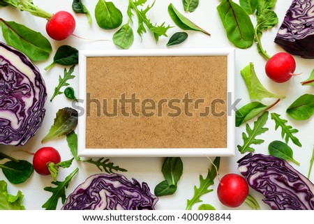 Vegetarian diet or clean eating concept background with a place for a text, white frame surrounded various locally grown vegetables - stock photo