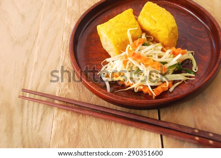 Vegetarian dishes made from  bean sprouts and yellow tofu fried look appetizing. This is chinese and thai food. - stock photo