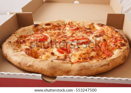 Vegetarian fast food. Margaretha or margarita pizza texture in pizza box. Pizza without meat. Tasty delicious pizza.