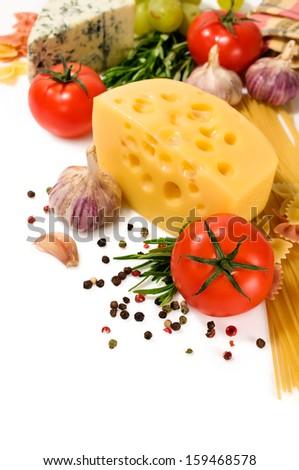 vegetarian food : ingredients for italian pasta on white background - stock photo