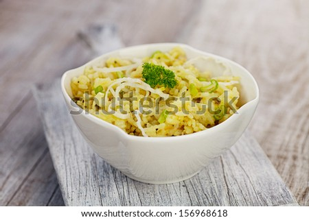 Vegetarian food. Leek risotto with garnish - stock photo