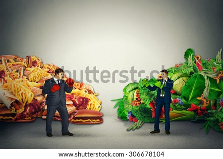 Vegetarian food representative fighting unhealthy junk fatty food guy with boxing gloves ready to punch each other. Diet battle nutrition concept idea - stock photo