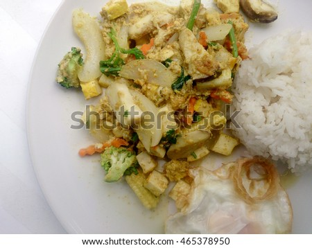 Vegetarian Food with fried mixed vegetables with tofu & thai jasmine rice on white dish, Healthy food. Thai food.