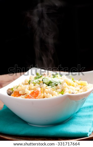 vegetarian gemelli pasta with farm fresh vegetables and parmesan cheese stock photo - stock photo