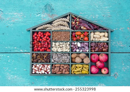 vegetarian healthy fruits, seeds and dried food ingredient collection in wooden box - stock photo