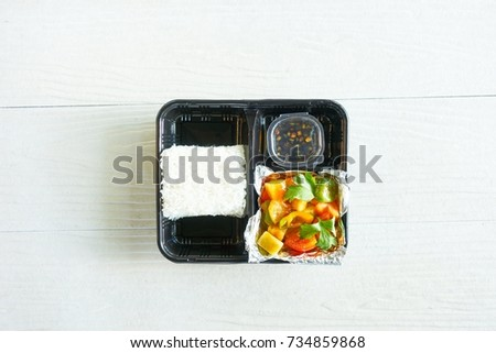 Vegetarian lunch box - Rice and Fried Stir Sweet and sour sauce with vegetable