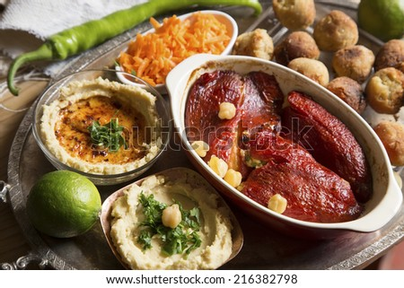 Vegetarian meal with hummus, falafel and roasted peppers - stock photo