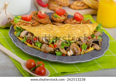 Vegetarian omelet, eat clean food, herbs, microgreens and mushrooms with chilli - stock photo