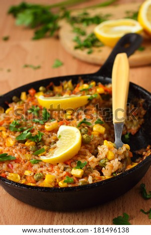 Vegetarian paella with corn - stock photo
