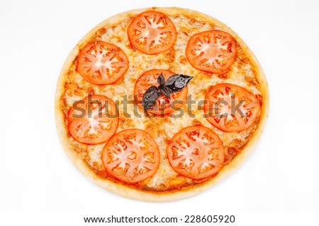 Vegetarian pizza with cheese, tomatoes and basil leaf - stock photo