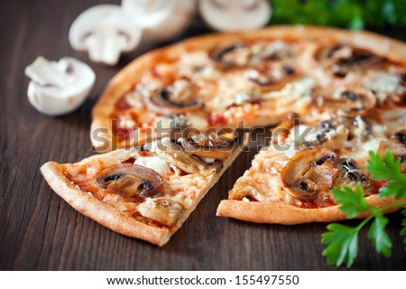 Vegetarian pizza with mushrooms, selective focus - stock photo