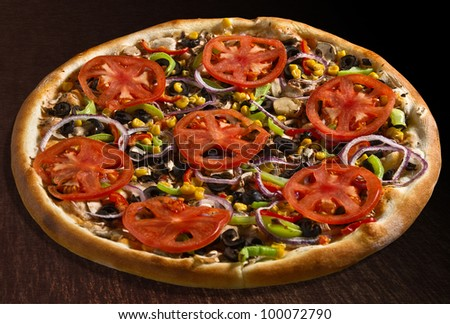 Vegetarian pizza with tomatoes, bell pepper, corn, olives, mushrooms and onion - isolated Collection of dozens of various pizza (30 items) - stock photo
