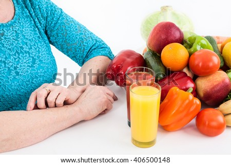 Vegetarian products: fruits, vegetables and fresh orange and tomato juices, isolated on white background - stock photo