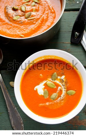 Vegetarian pumpkin-lentils cream soup with pepo seed - stock photo