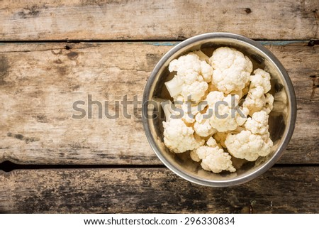 Vegetarian recipe or menu background with copy space. Cauliflower in a bowl - stock photo