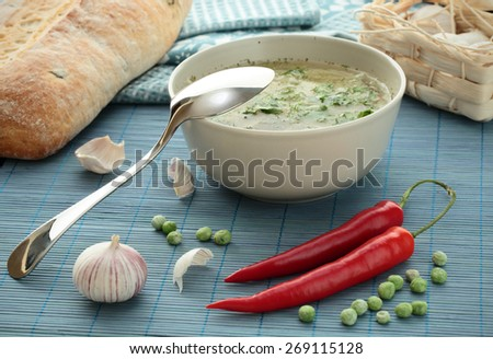 vegetarian soup with red pepper and garlic - stock photo