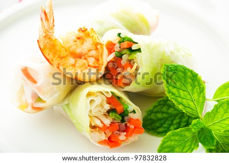 Vegetarian spring roll with carrot, soy sprouts and shrimp on white background as a studio shot - stock photo