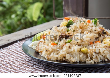 Vegetarian stir-fried rice and spoon